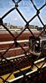 Behind the fence. Here is the train. Queensboro Bridge, Queens NY