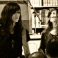 Sarah Lipstate(Noveller) left and Sarah Register(right) during the US premiere of Ben Frost\'s Music for 6 Guitars. Rose Main Reading Room in NY public library.