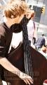 A Jazz Bassist performing, Columbus Circle at 59th Street NY