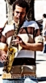A Jazz Saxophonist performing, Columbus Circle at 59th Street NY
