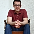 Dan sitting on the model chair. Contentious Reality studio in Chickopee, MA
