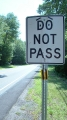 Do Not Pass. Somebody made it a piece of art with the addition of the sad face. Aperture priority mode