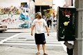 A guy and the phone box near SOHO. NY