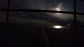 Old Saybrook Causeway looking towards Connecticut River and Long Island Sound. The moon hiding between the rails and creating a haunted feeling. Low angle