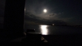 Old Saybrook Causeway looking towards Connecticut River and Long Island Sound. The moon visible in the distance and creating a haunted feeling. Low angle