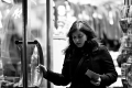 Soulafa Khanom stepping out of a shop. Fifth(ish) Avenue New York, NY