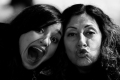 Soulafa Khanom and Lilly Khanom Making Funny Faces near Bryant Park Pond. New York, NY