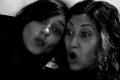 Soulafa Khanom and Lilly Khanom Making Funny Faces near Bryant Park Pond. New York, NY