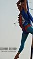 Flying: seen at Coney Island Mermaid Parade. Brooklyn, NY. Solstice week 2010