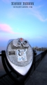 Tower Optical binocular viewer seen at Saybrook Point park around 8:00 PM. Solstice  week 2010. Saybrook Marina & moon in the distance