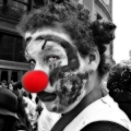A red nosed clown with red eyes seen on the day of the Zombie march around South Street Station. Boston, MA